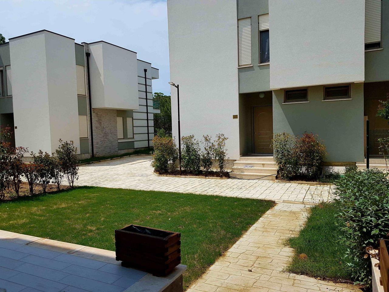villas for sale in lalzi bay at perla resort